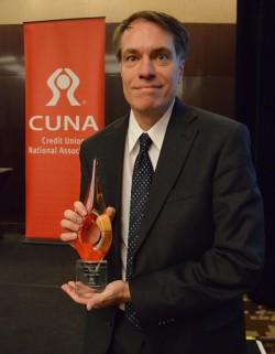 Alternatives CEO, Tristram Coffin, accepts CUNA award